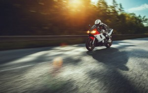 30018874 - man riding motorcycle in asphalt road